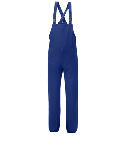 Anti tangle dungarees, elasticated suspenders, side opening, breast pocket closed with velcro, blue color. UNI EN 510 and UNI EN 340: 04 Certificate